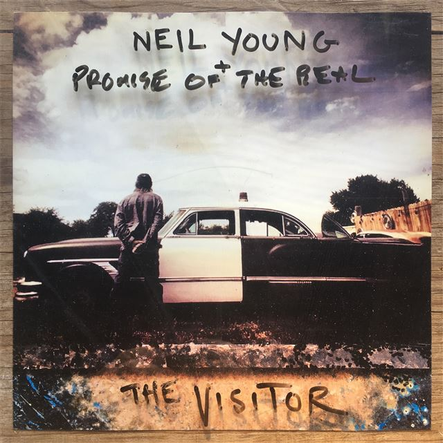 """Neil Young + Promise of the Real Releases""""The Visitor"""""""